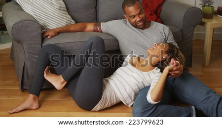 African American couple talking on floor