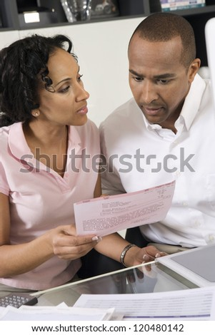 African American couple worried over excess domestic bill