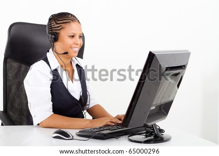 african american customer service consultant sitting at desk