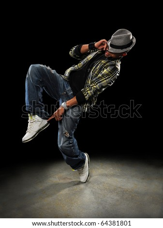 African American dancer performing over dark background
