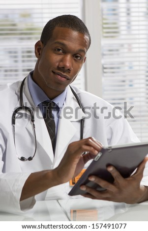 African American doctor with tablet, vertical