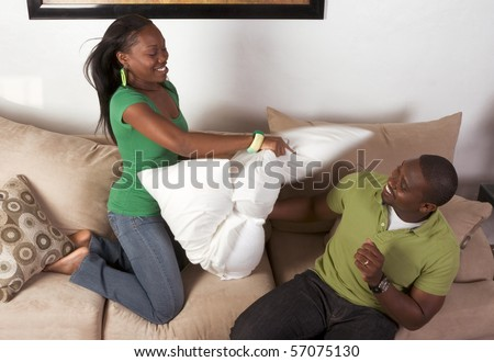 African-American ethnic black couple in pillow fight (motion blur)