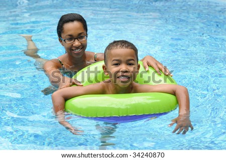 African American family in a swimming pool