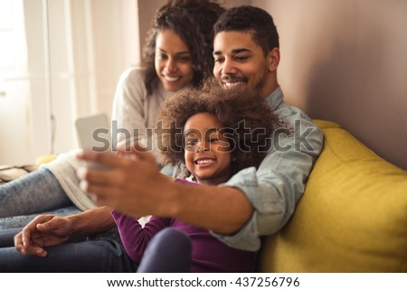 African american family making a selfie together.
