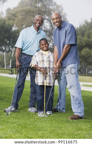 African American family playing golf