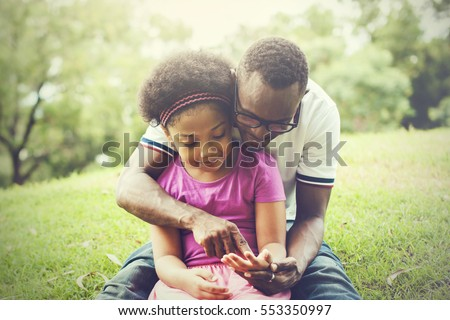 African American family playing together in the outdoor park
