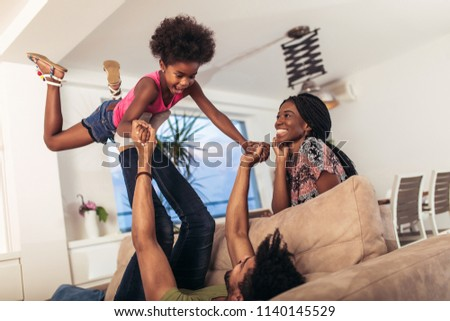 African american family spending time together at home. They are having fun #1140145529