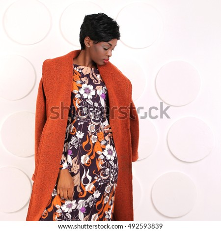 9c026d787e6 African-american fashion style. Beautiful African woman wearing color dress  looking down. Latin
