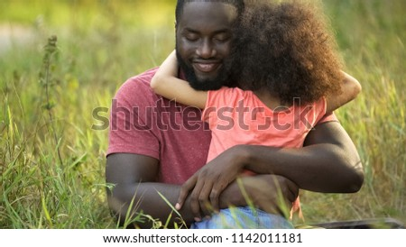 African american father enjoying pleasure pastime with his little daughter