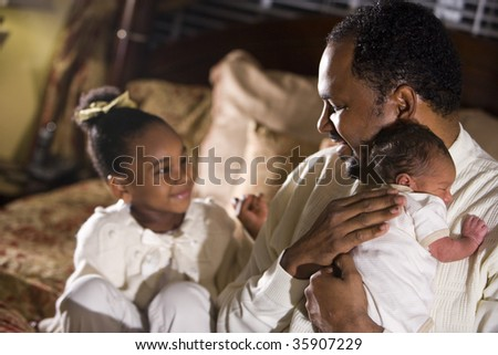 African American father with his beautiful children - stock photo