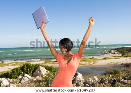 african-american female at beach with laptop