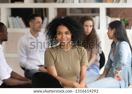 African american female psychologist psychotherapist looking at camera during group therapy session, black woman coach counselor therapist posing during team training with diverse people, portrait