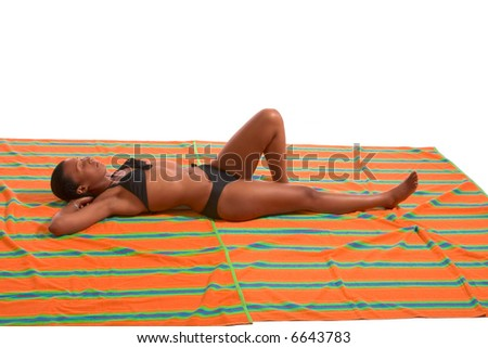 African-American female relaxing and taking sunbath (isolated)