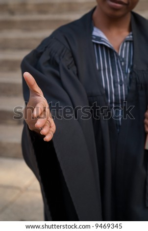 African American female woman lawyer shaking hands outside court house