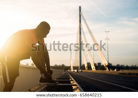 African american fitness handsome man training. Jogging against the morning sun. #658640215