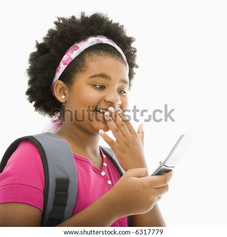 African American girl with backpack talking on cell phone.