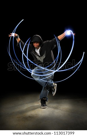 African American hip hop dancer performing with light painting