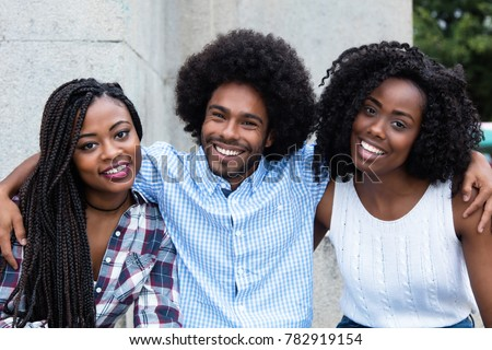 African american hipster man with two beautiful woman