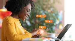 African American Lady Using Laptop Texting In Online Social Media Chat Networking Sitting In Cafe Indoors. Internet Content Concept. Panorama, Collage With Web Icons