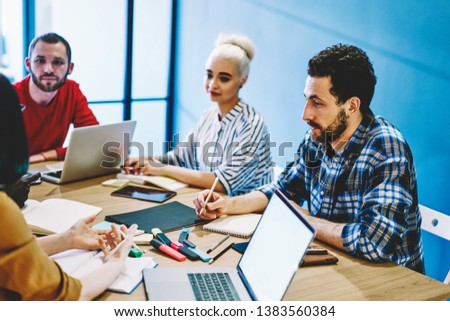 African american leader of working crew having meeting with multiracial colleagues in office cooperating and share ideas together, male and female employees brainstorming and talking about strategies