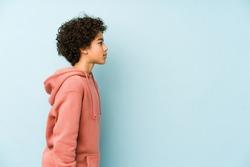 African american little boy isolated gazing left, sideways pose.