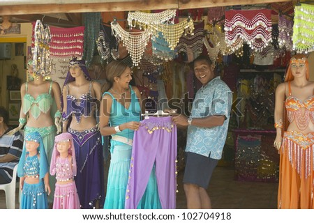 African American looking at belly dancing outfits