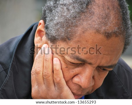 African american male feeling sad and depressed.