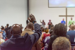 African American Man at Church with His Hand Raised