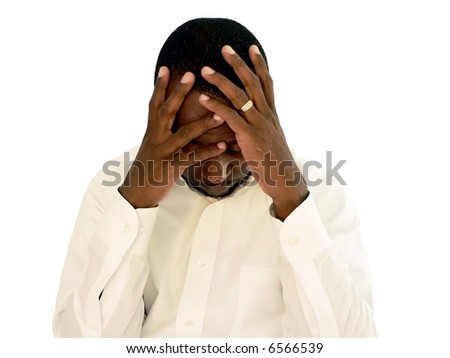 african american man holding his head as if under stress