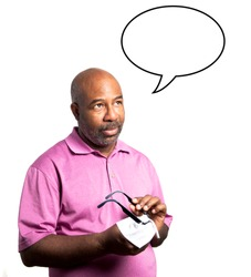 African American man in a a purple shirt cleaning the lenses of a pair of eyeglasses with a microfiber cloth on white background. Speech think bubble