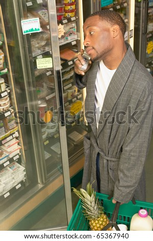 African American man in bathrobe at grocery store