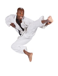 african american man in karate suit, suspended in mid air