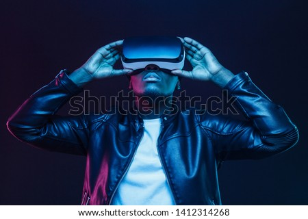 African american man in vr glasses, watching 360 degree video with virtual reality headset isolated on black background #1412314268