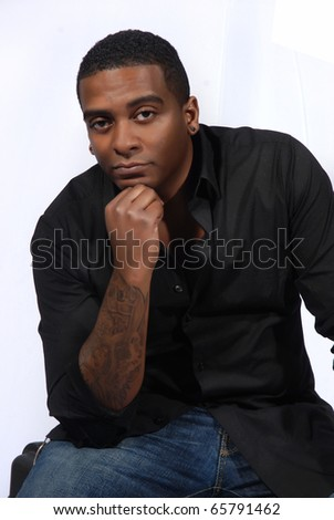 African American man posing with hand on his chin.  In thinking position