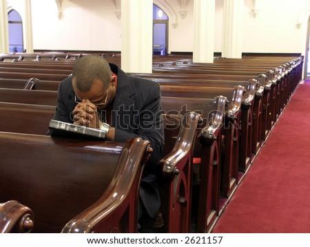 African-American man praying alone. - stock photo