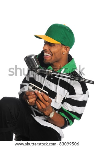 African American man singing into vintage microphone isolated over white background