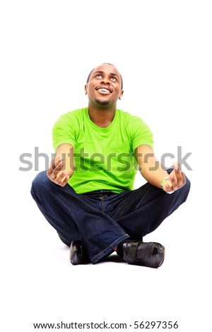 African American man sitting in yoga position on white background