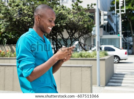 African american man surfing the net with mobile phone