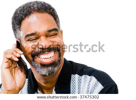 African American man talking on a mobile phone isolated over white - stock photo