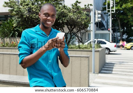 African american man using 4g with mobile phone