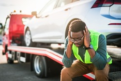 African American man using towing service for help car accident on the road. Roadside assistance concept.