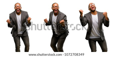 African american man with beard happy and excited celebrating victory expressing big success, power, energy and positive emotions. Celebrates new job joyful #1072708349