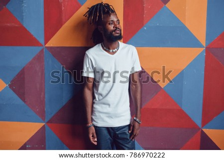 Shutterstock African American man with dreadlocks and a white T-shirt. Mock-up.