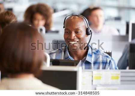 African American man working at a computer in a call centre #314848505