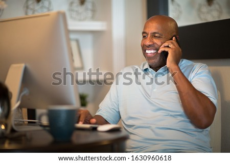 African American man working from his home office.
