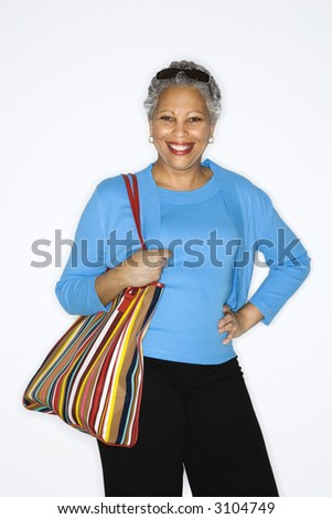 stock photo african american mature adult female holding big purse 3104749 Adult Halloween Costumes Ho Halloween Costume