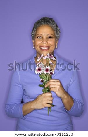stock photo african american mature adult female holding flowers 3111253 SleepingBitch.com   sleeping sex, sleeping porn, com, sleeping teen, movie