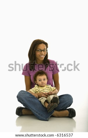 stock photo african american mid adult mom sitting with toddler son on lap looking at viewer 6316537 Mandingo Porn 24/7 Direct to your computer. | Mandingo Porn