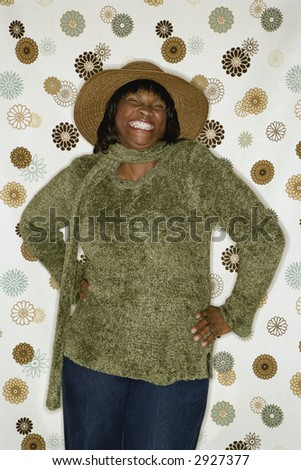 African-American  mid-adult woman in front of vintage pattern background.