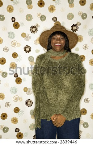 African-American  mid-adult woman portrait in front of vintage pattern background.